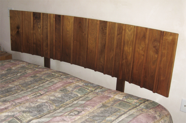 Walnut headboard for king size bed with random width boards and raised dividers