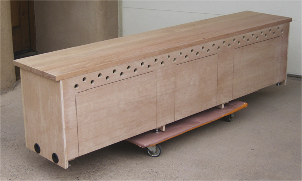 Allin TV Stand Showing Back Of Cabinet With Future Cutouts And Ventilation  Holes Unfinished
