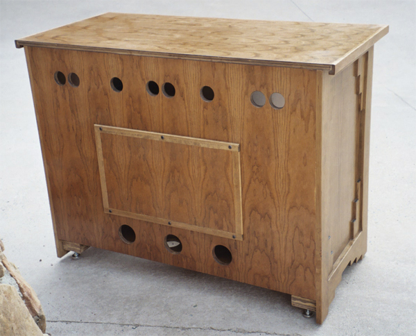 Ingalls entertainment center showing rear view with access panel and ventilation
